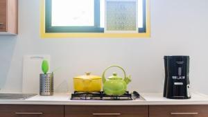 A kitchen or kitchenette at Bubali Bliss Studios