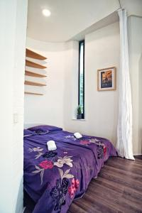 A bed or beds in a room at Apartment Breeze
