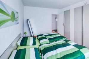Ein Zimmer in der Unterkunft Ferienwohnung in Augsburg