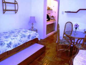A bed or beds in a room at Apartamento Figueiredo Magalhães