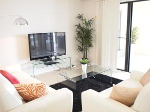 A television and/or entertainment centre at Edge Apartments Cairns