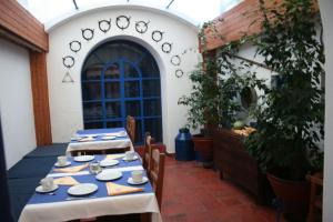 A restaurant or other place to eat at Casas De Romaria