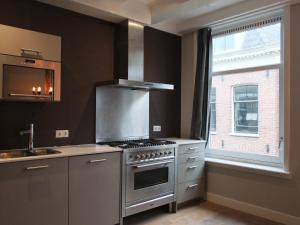 A kitchen or kitchenette at Cityden Old Centre Serviced Apartments