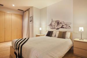 Säng eller sängar i ett rum på Urquinaona