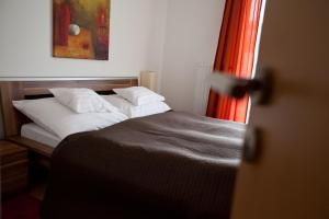 A bed or beds in a room at Vivaldi Apartments Budapest
