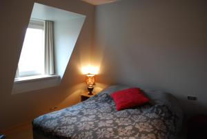 A bed or beds in a room at House of Columbus
