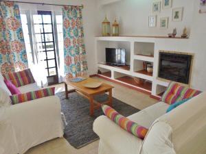 A seating area at Apartamento Neptuno