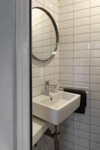 A bathroom at R73 Apartments