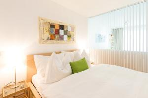 A bed or beds in a room at Rafael Kaiser - Aurea Apartment