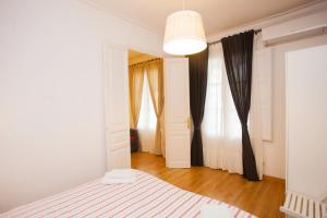 A bed or beds in a room at M64 Apca Rent