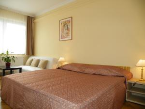 A bed or beds in a room at Apartment Buda Budapest
