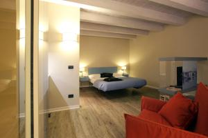 A bed or beds in a room at Corte San Luca Apartments