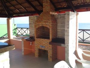 Barbecue disponible mis à disposition des clients de l'appart'hôtel