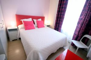 A bed or beds in a room at Stopbarcelona Universidad Apartments