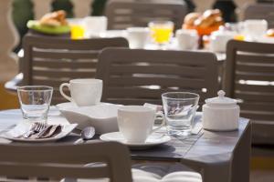 Restaurant ou autre lieu de restauration dans l'établissement Hôtel Corniche du Liouquet