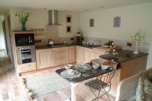 A kitchen or kitchenette at Falstone Farmhouse & Barns