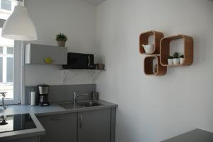 A television and/or entertainment center at Apartment Terre de Brume