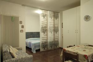 Кровать или кровати в номере Villa Bruna