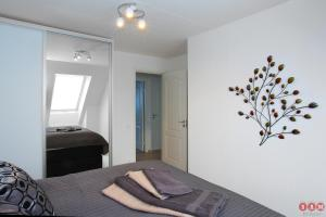 A bed or beds in a room at Serviced Apartments Malmö