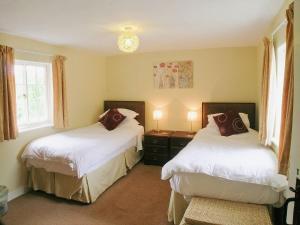 Voodi või voodid majutusasutuse Lock Cottage toas