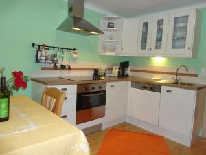 A kitchen or kitchenette at Landhaus Arztmann