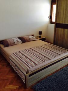 Кровать или кровати в номере Apartments Svorcan