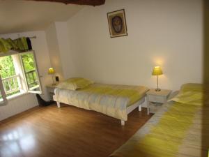 Un ou plusieurs lits dans un hébergement de l'établissement Domaine Saint-Joly