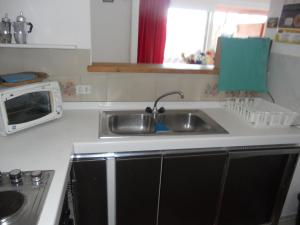 A kitchen or kitchenette at Amare il Mare