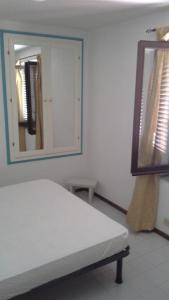 A bed or beds in a room at Arbatax Attico Rocce Rosse