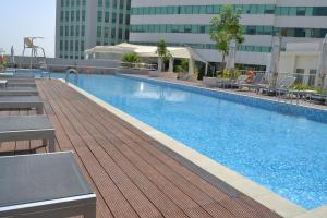 The swimming pool at or near Millennium Executive Apartments Muscat