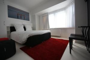 Un ou plusieurs lits dans un hébergement de l'établissement Luxe Apartment Filine