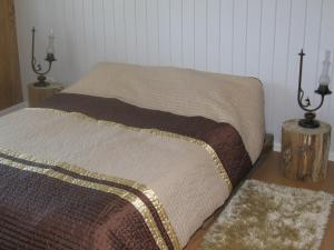 A bed or beds in a room at Casa Do Pinheiral