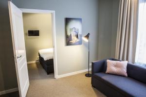 Ein Sitzbereich in der Unterkunft Apartments Prinsengracht