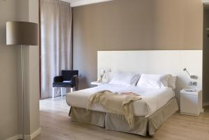 A bed or beds in a room at Rambla 102