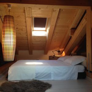 Letto o letti in una camera di Marco Polo Lodge