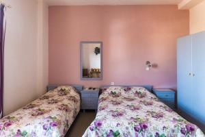 A bed or beds in a room at Knossos Apartments