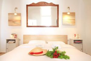 A bed or beds in a room at Residence Suites