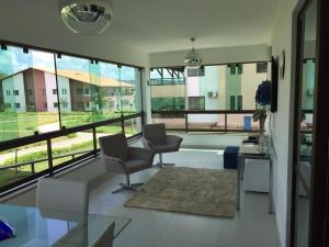 A seating area at Flat Canárius Residence Gravatá