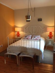 A bed or beds in a room at Alma N' Sleep