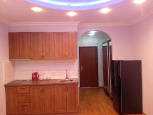 A kitchen or kitchenette at Orbi Residence