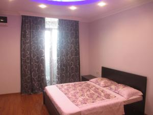 A bed or beds in a room at Orbi Residence