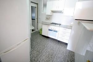 A kitchen or kitchenette at Near Maresme Forum Apartment