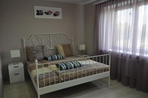 A bed or beds in a room at New Fortres Apartment №2