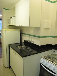 A kitchen or kitchenette at Alex Rio Flats Studio Beach View