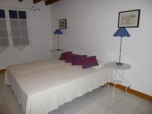 A bed or beds in a room at C'est la Vie - Le Gite