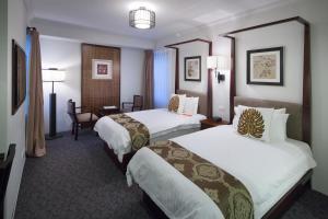 Cama o camas de una habitación en Pagoda Resort & Spa