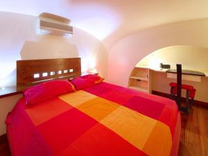 Letto o letti in una camera di Sweet Home Colosseo