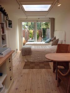 Een bed of bedden in een kamer bij BBBoekelo