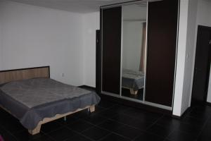 Ліжко або ліжка в номері Делюкс на Вокзалі