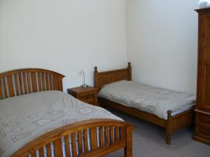 A bed or beds in a room at Knotts Farm Holiday Cottages